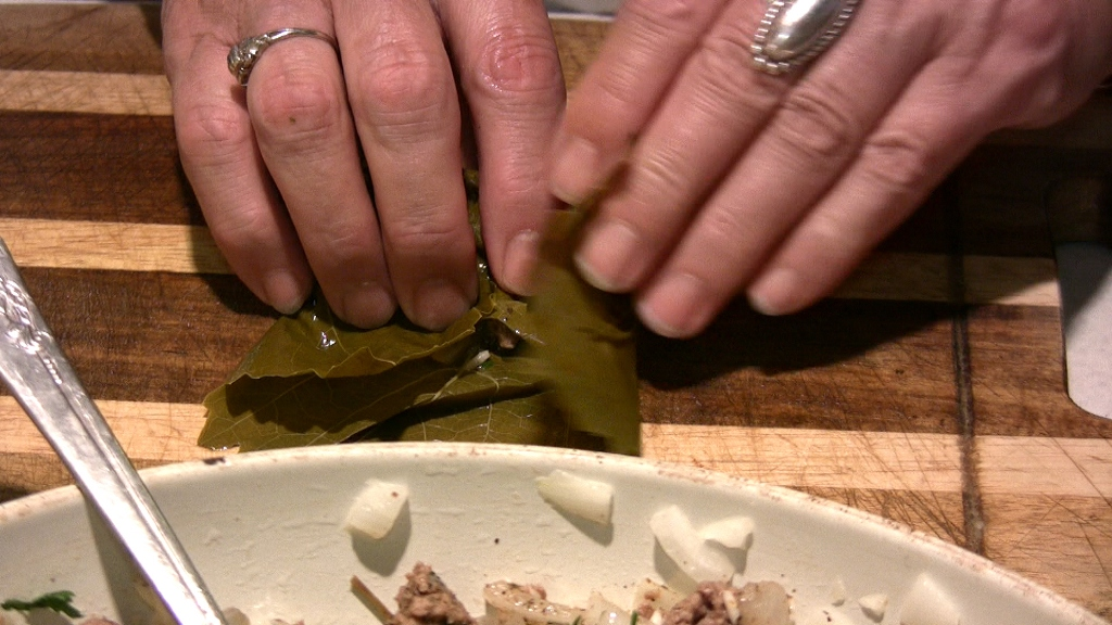 Click to enlarge - Carefully roll filling inside the grape leaf. Not ...